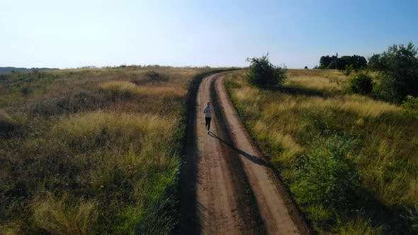 Thumbnail for Runner Running on the Rural Road