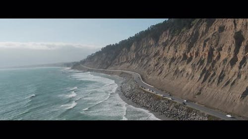Aerial Drone Shot of a Road Lining a Scenic Coastline (Pacific Coast Highway, California)