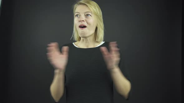 Thumbnail for Attractive Blonde Claps Hands with Opened Mouth at Audition