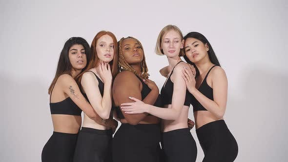 Tolerant International Group of Models Gathered Together Posing at Camera