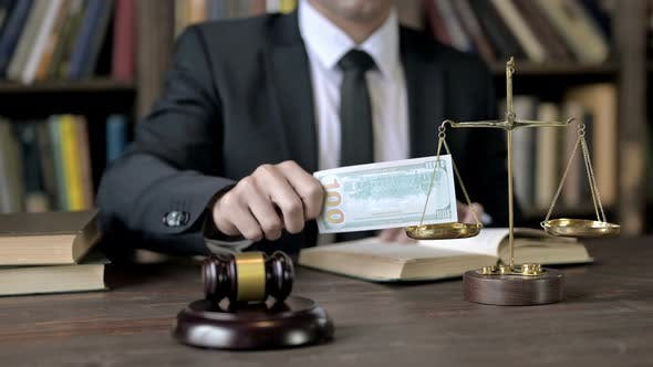 Thumbnail for Close Up Shoot of Judge Hand Putting Money in Scale