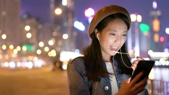 Thumbnail for Woman look at smart phone in city at night