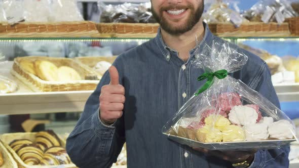 Thumbnail for Cropped Shot of a Happy Bearded Man Showing Thumbs Up at the Bakery