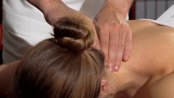 Thumbnail for Woman Receiving Relaxing Back Massage at Spa Center