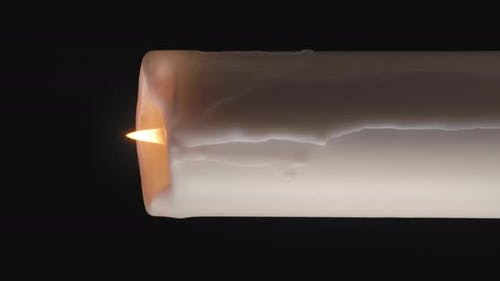 White Candle on Black Background. Vertical Video