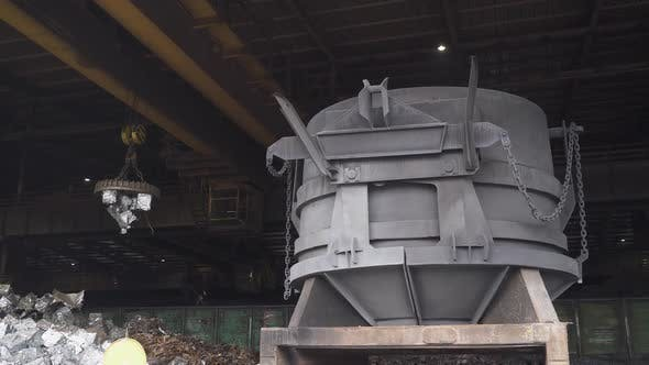 Steelmaking the Process of Loading Scrap Metal Into a Tank for Steel Melting Gantry Cranes with