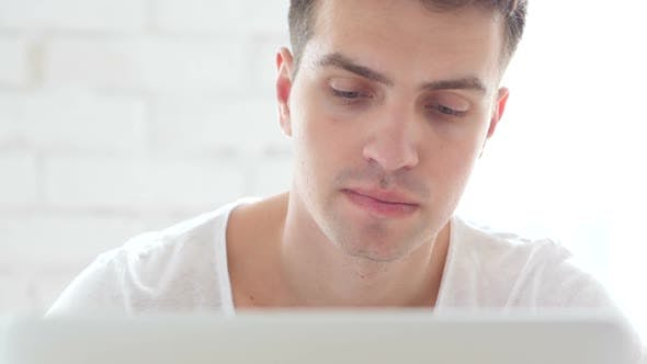 Thumbnail for Front Close-Up of Thinking Pensive  Man working Online