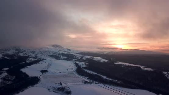 Thumbnail for Beautiful Winter Nature Aerial Footage Of Sunset In The Mountains