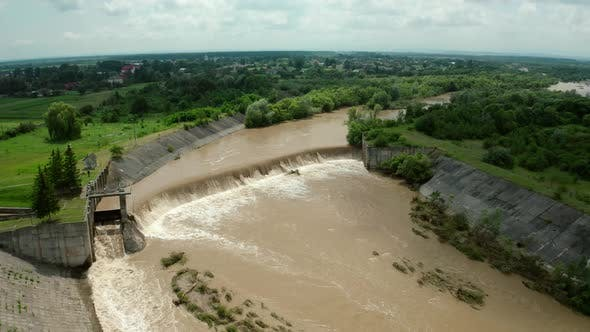 Aerial Drone View. River Water Move Down From with a Water Filled Dam After Heavy Floods and Rains