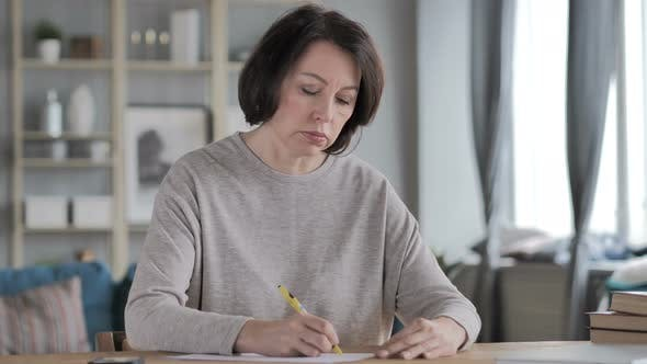 Thumbnail for Old Senior Woman Writing on Documents, Paperwork