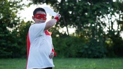 Hero boy in red at garden