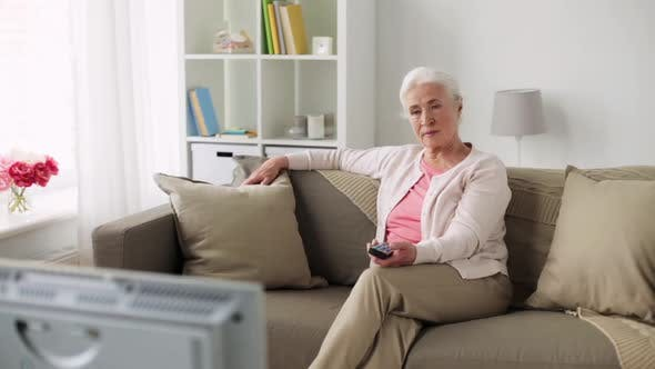 Thumbnail for Happy Senior Woman Watching Tv at Home