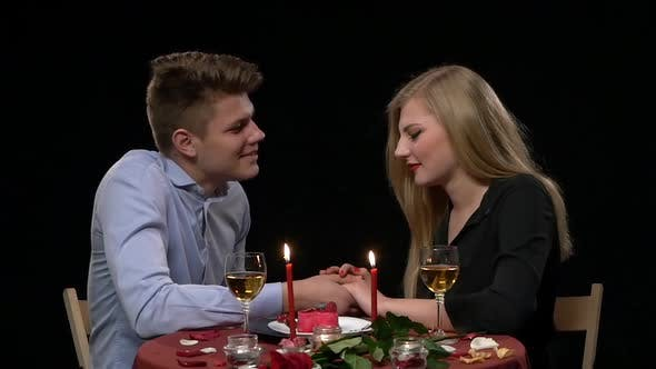 Thumbnail for Portrait of Beautiful Couple Enjoying Each Other's Company in a Romantic Dinner. Close Up, Slow