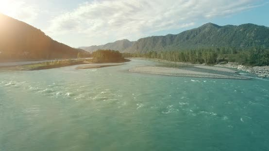 Thumbnail for Low Altitude Flight Over Fresh Fast Mountain River with Rocks at Sunny Summer Morning.