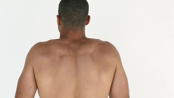 Thumbnail for Man stretching shoulders and back, rear view