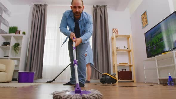 Low Angle Mopping the Floor