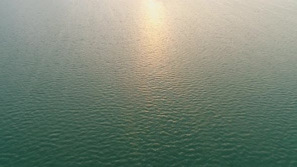 Thumbnail for Aerial Over Water Surface on the Sunset, Sun Track Sparks