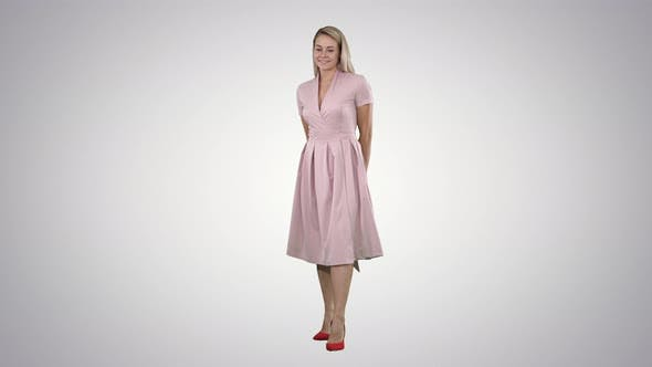 Thumbnail for Happy Beautiful Woman in Pink Dress Posing on Gradient Background.