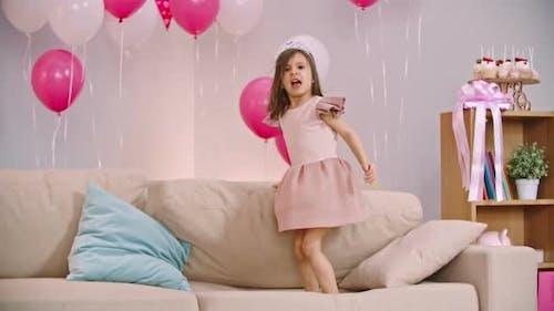 Little Princess Jumping on Sofa