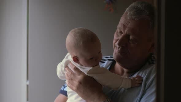 Thumbnail for Grandfather Holding His Newborn Granddaughter