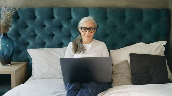 Thumbnail for Elderly Woman Working on Laptop