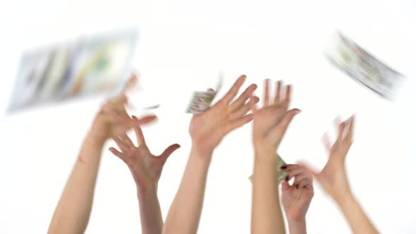 Many Hands Catch Falling US Dollars