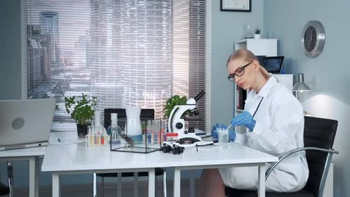 In Modern Chemistry Lab Female Research Scientist Using Pipette