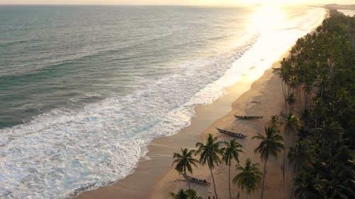 Ocean waves break on tropical beach during sunset. Zanzibar Island, Africa. 4K