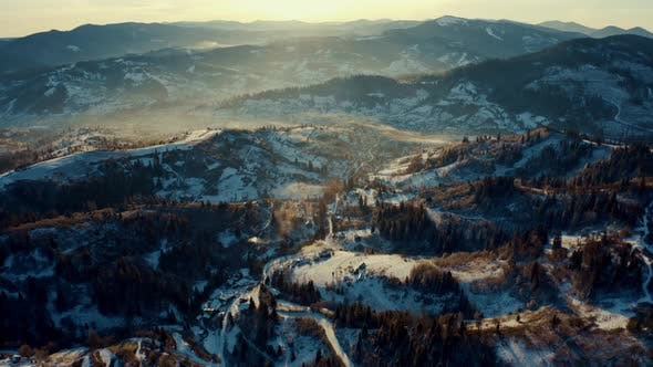 Aerial View of the Village in Winter Mountains, Sunrise in Winter Carpathian Mountains, Aerial View