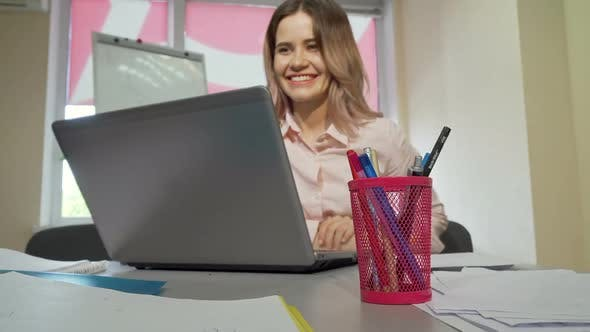 Lovely Female Student Video Calling Someone Using Her Laptop