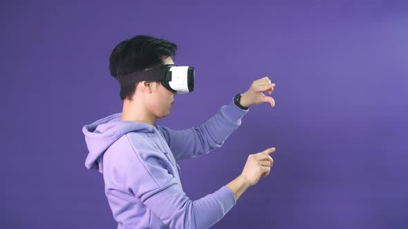 Thumbnail for Man Using Virtual Reality Headset at Office