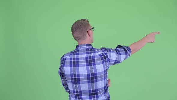 Thumbnail for Rear View of Young Hipster Man Pointing Finger
