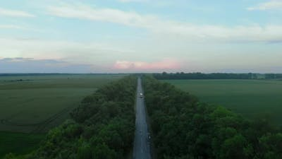 Top View on Driving Truck through Green Field
