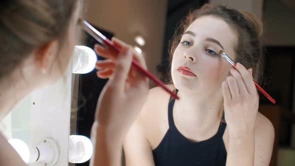 Thumbnail for Young Woman Doing Makeup