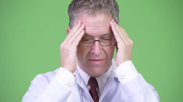 Thumbnail for Portrait of Stressed Mature Man Doctor Having Headache
