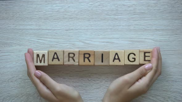 Thumbnail for Marriage, Hands Pushing Word on Wooden Cubes, Family Wife Husband and Children