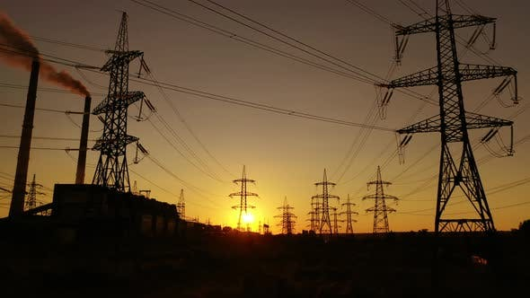 High-voltage power lines at sunset