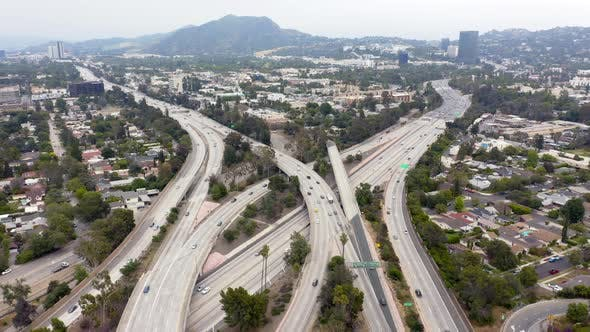 Thumbnail for Aerial Los Angeles Infrastructure View with Freeway Constructions, Buildings and Automobiles