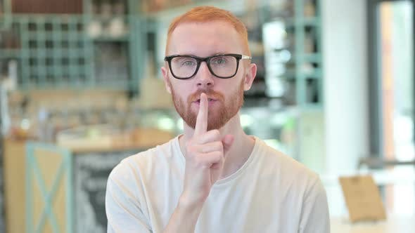 Thumbnail for Portrait of Young Redhead Man with Finger on Lips, Quiet