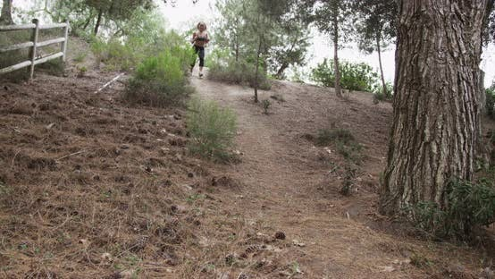 Thumbnail for Healthy Asian woman running down hill at the park