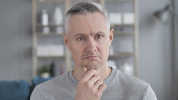 Thumbnail for Portrait of Pensive Middle Aged Gray Hair Man Got New Idea