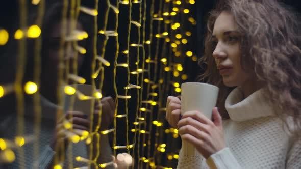 Thumbnail for Contemplative Girl Drinking Tea