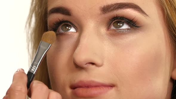 Cover Image for Beauty Girl with Makeup Brush, Close Up, Slow Motion