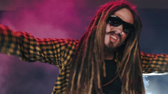 Thumbnail for Dj Man with Dread Locks in Glasses Play Music with Hands Up