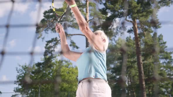 Thumbnail for Successful Joyful Happy Mature Woman Won the Tennis Tournament. The Old Lady Jumping Raising Hands