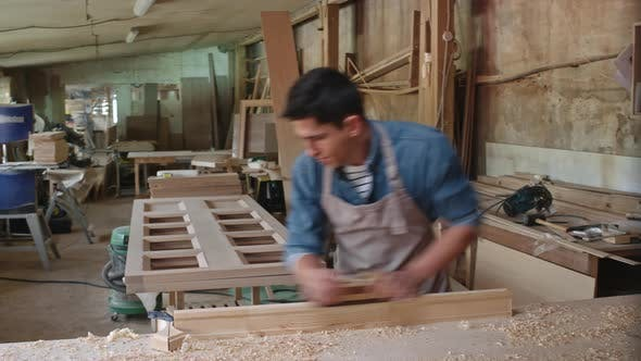 Thumbnail for Carpenter Shaping Plank with Hand Plane