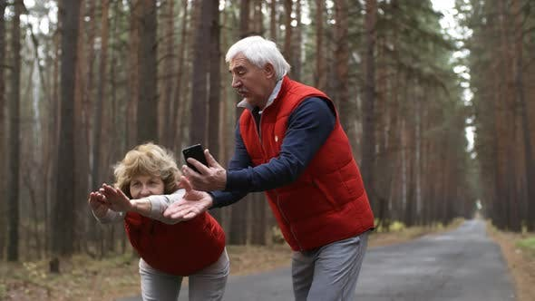 Thumbnail for Retired Athletes with Smartphone on Outdoor Training