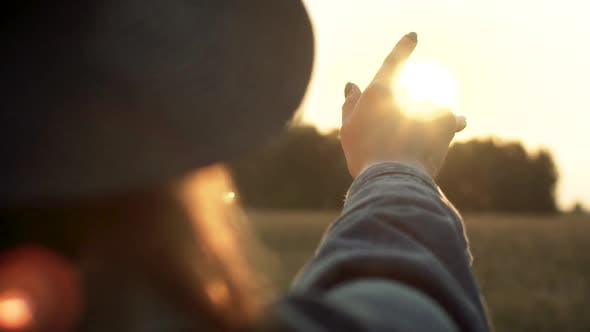 Thumbnail for Hand Playing With Sun Rays