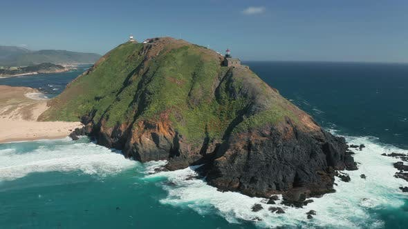 Thumbnail for Panoramic Aerial View on Incredible Shore with Lighthouse on High Rocky Island.