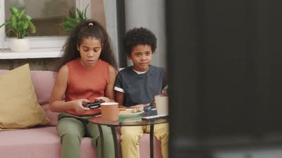 Afro Kids Playing Video Games